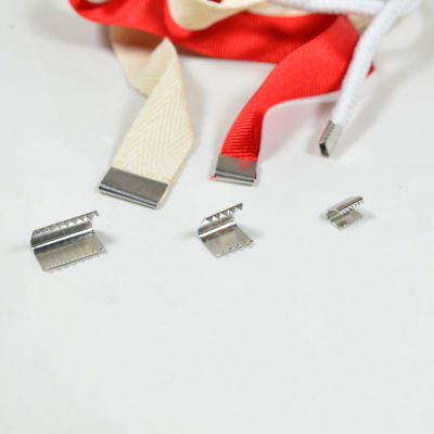 Metal lace end clamp